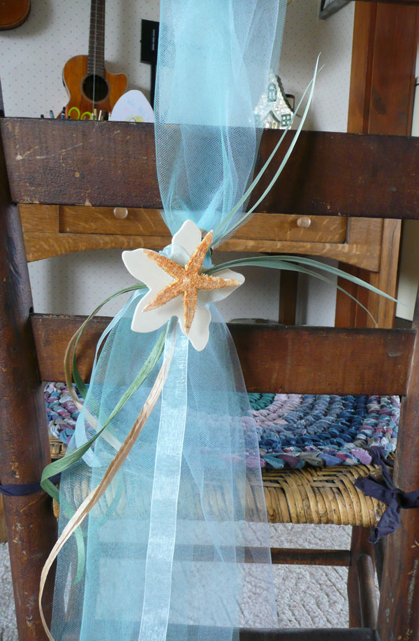 beach wedding chair sash We alternated different shades of blue and green