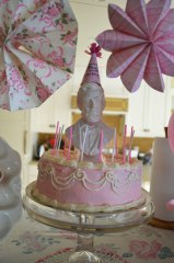 An Avon aftershave bottle makes an elegant cake topper. Got the candles in a garage sale free-box!
