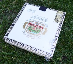 $4 cigar box with two cable clips and a vecro closure