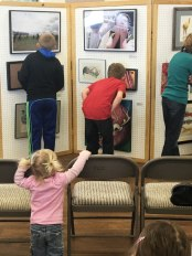 A few younger siblings also viewed the exhibit.