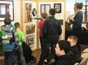 The students took turns viewing the exhibit closely.